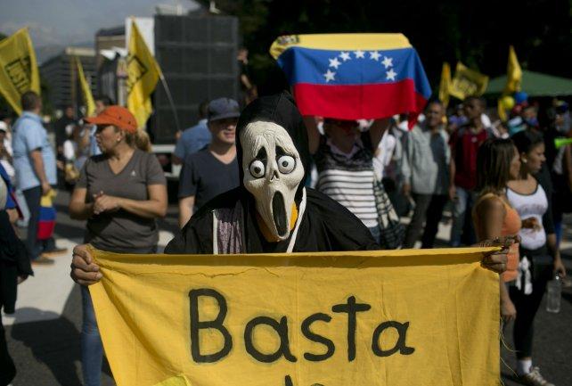 Manifestantes en contra de Maduro.
